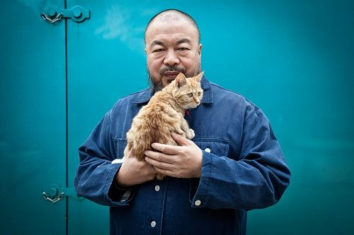 Aiweiwei/艾未未 poses for a portrait in his studio compound.