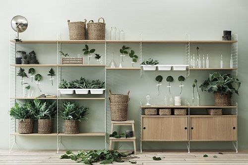 string® system - floor panels and wall panels in white. shelves and cabinets in oak. bowl shelf in white