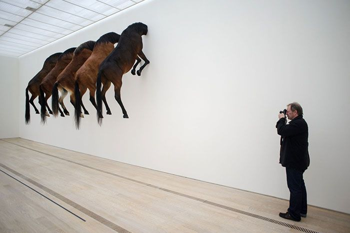 A photograph shoots an art project by Italian artist Maurizio Cattelan at the Beyeler Foundation in Basel on June 10, 2013 during a press day for the Art Basel 2013 international art show, which opens to the public on June 13. AFP PHOTO / SEBASTIEN BOZON RESTRICTED TO EDITORIAL USE, MANDATORY MENTION OF THE ARTIST UPON PUBLICATION, TO ILLUSTRATE THE EVENT AS SPECIFIED IN THE CAPTIONSEBASTIEN BOZON/AFP/Getty Images ORG XMIT: 409