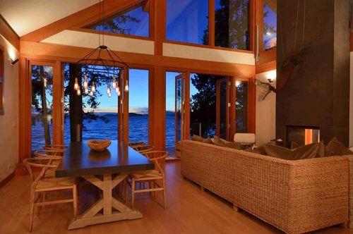 vista nocturna salon comedor casa madera vista noche