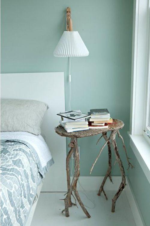 Rincón habitación verde diseño escandinavo.