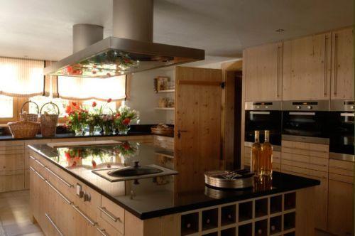 casa gstaad suiza cocina madera