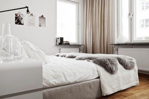 Dormitorio nórdico blanco y gris