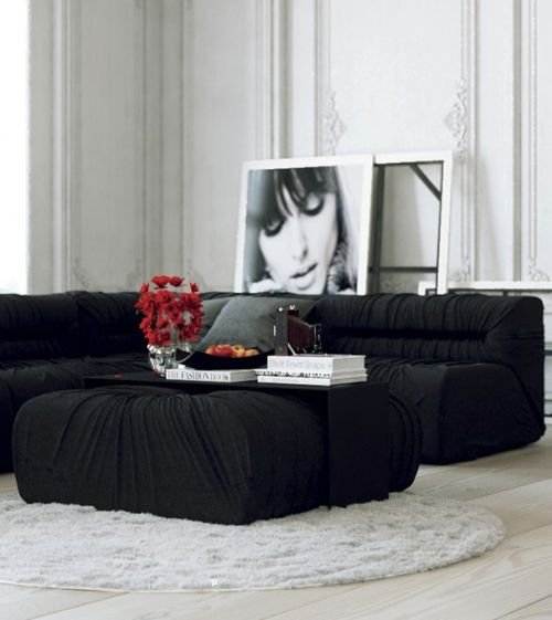 Parisian-Apartment-monochrome-living-with-white-walls-and-red-accents2-600x673
