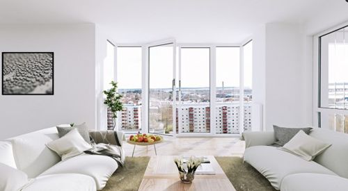 Scandinavian-Apartment-white-living-floor-to-ceiling-windows-600x330