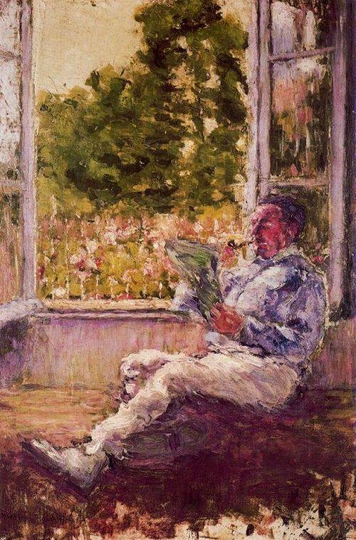 hombre sentado en una ventana