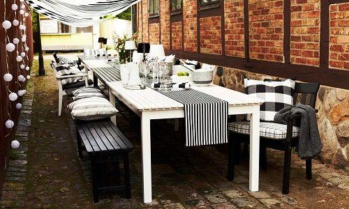mesa exterior con camino de mesa