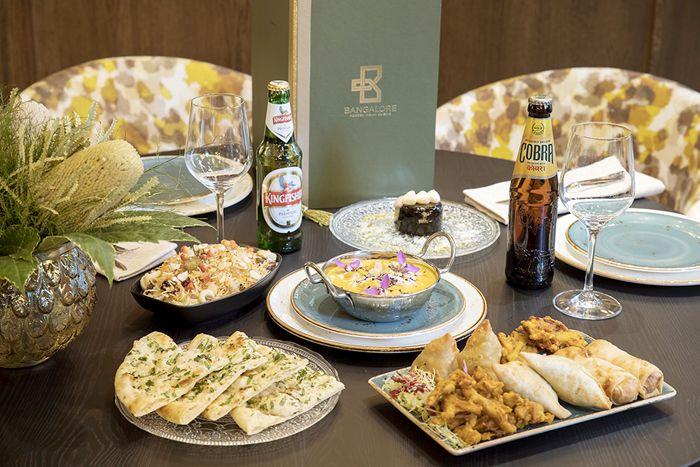 menu indio completo con platos principales y cervezas