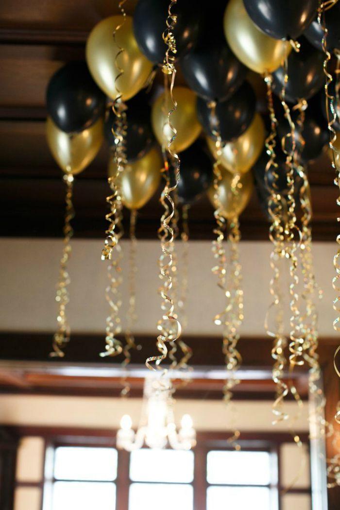 globos dorados negros