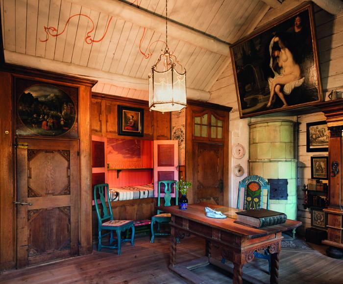sala rustica madera cuadros
